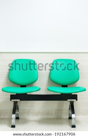 two empty chairs at waiting room - stock photo
