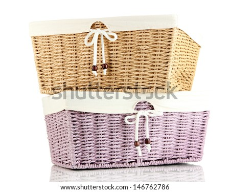 Two empty color wicker baskets, isolated on white
