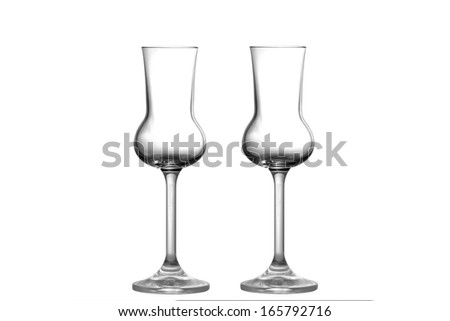 Two empty Grappa glasses upright position - stock photo