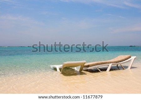 Two empty loungers on the beach