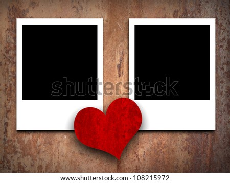 Two empty photographs and heart - stock photo