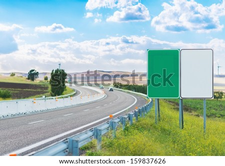 Two empty road signs near highway - stock photo