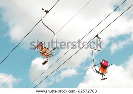 Two empty ski lifts - stock photo