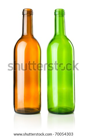 Two empty transparent green and brown wine bottles on white - stock photo