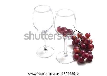 two empty wine glass with bunch of grapes - stock photo
