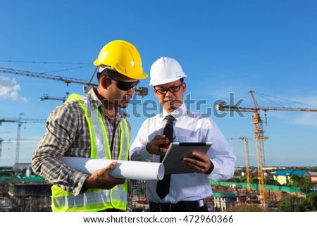 Two engineers working in a construction site.