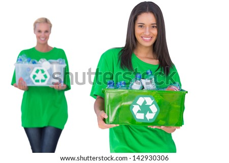 Two enivromental activists holding box of recyclables on white background