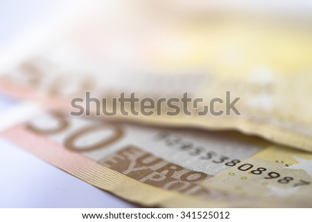 Two 50 euro banknotes with shallow depth of field - stock photo
