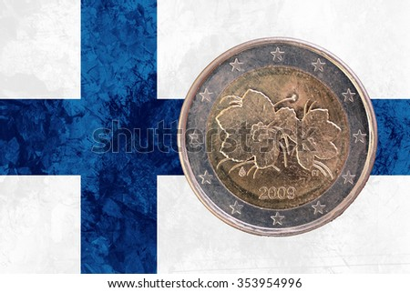 Two euros coin from Finland isolated on the national finnish flag as background