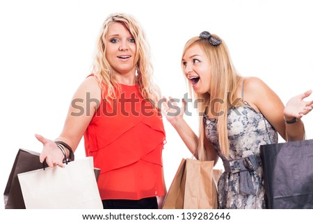Two excited blond girls arguing and shopping, isolated on white background - stock photo