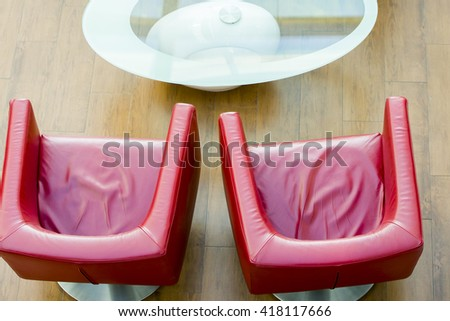 two fashion red armchair on a wooden floor - stock photo