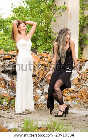 two fashionable girls on the dirty industrial place - stock photo