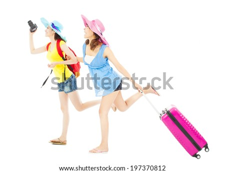 two female backpackers happy to travel worldwide  - stock photo