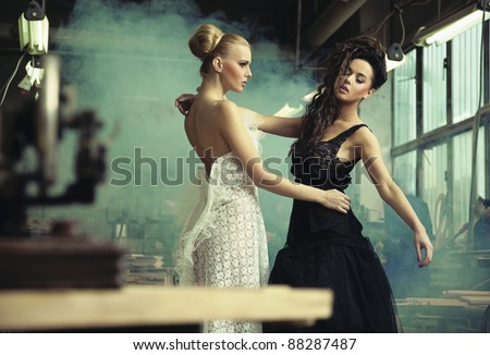 Two female beauties in a dancing pose - stock photo