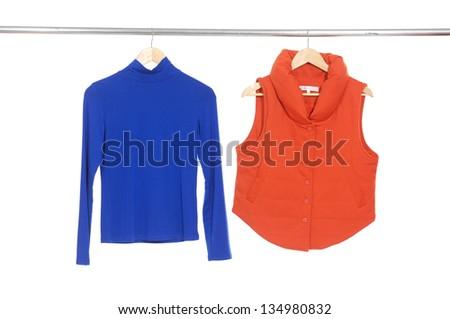 Two female blue and orange dress isolated on hanging - stock photo