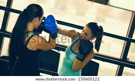 Two Female Boxers At Boxing Ring Fighting - stock photo