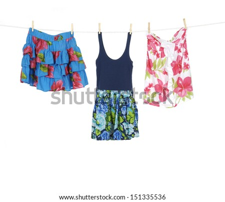Two female clothing and flower shorts on hangers at the show