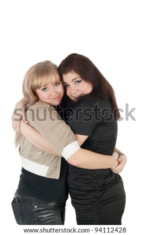 two female friends embracing