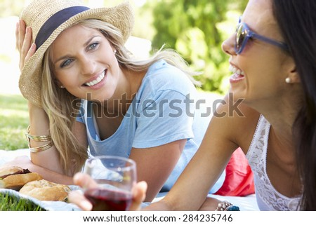 Two Female Friends Enjoying Picnic Together - stock photo