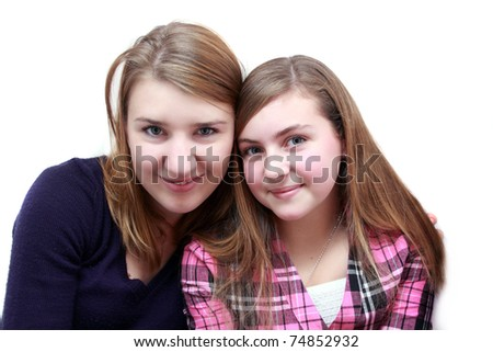 Two female friends sitting close together
