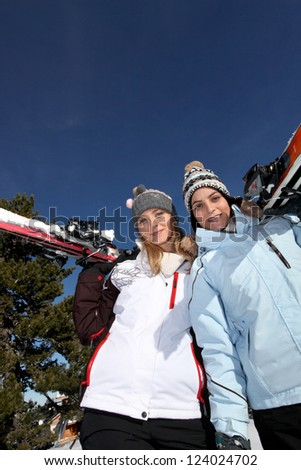 Two female friends skiing - stock photo