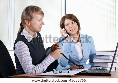 two female in office with laptop