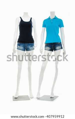 Two female mannequin in trousers, jeans shorts and blue shirt  - stock photo