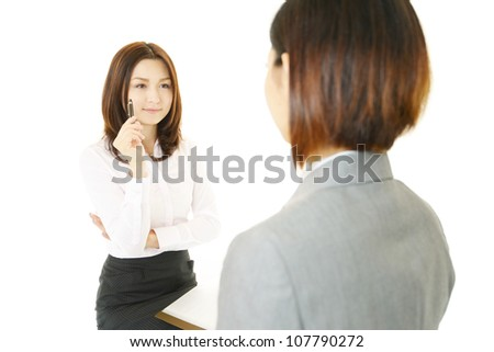 Two female office workers who consult?about?the work - stock photo