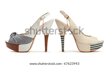Two female open-toe shoes on the white background - stock photo