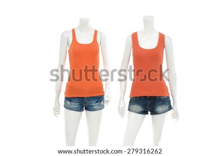 Two female orange shirt in jeans shorts on mannequin - stock photo