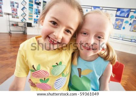 Two Female Primary Schoolchildren In Classroom - stock photo