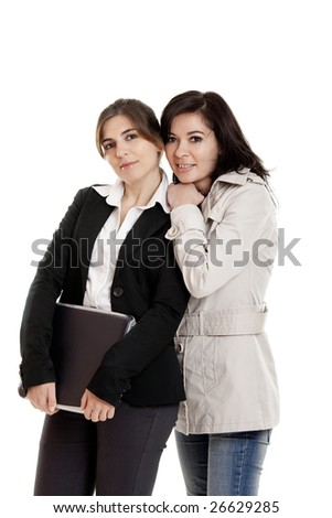 Two female young students over a white background - stock photo