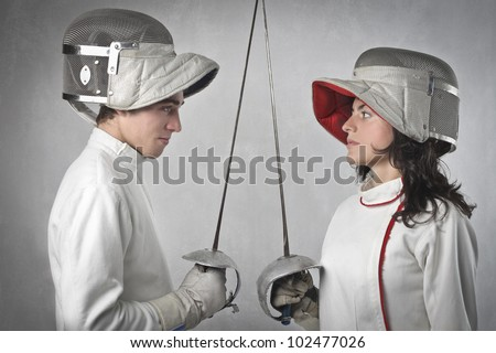 Two fencers facing each other before the match - stock photo