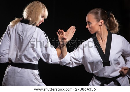 Two fighters in white kimonos ready to start. - stock photo