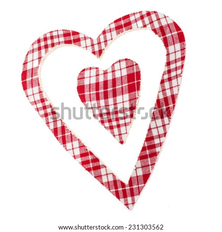 two figures in the shape of heart of checkered fabric in red cell  isolated on white background - stock photo