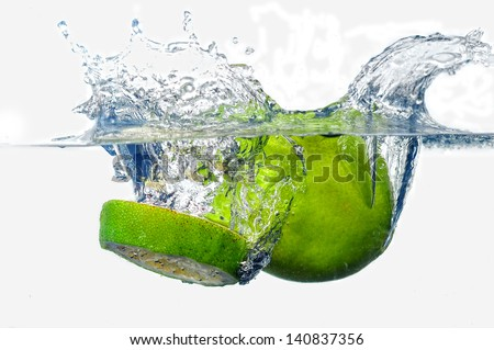 two file pieces, falling in water, with the splashing - stock photo