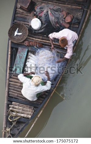 Two fishermans on a boat - stock photo
