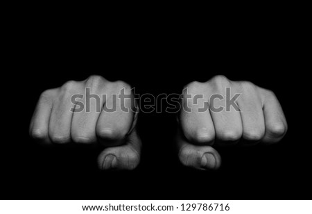 Two fists isolated on black