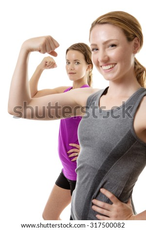 two fitness woman showing you how strong there are by flexing their arms