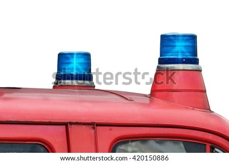 Two flashing blue lights on a fire truck. - stock photo