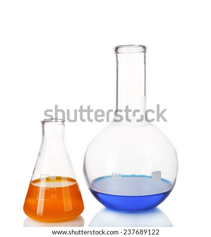 Two flasks with blue and orange fluid on table isolated on white