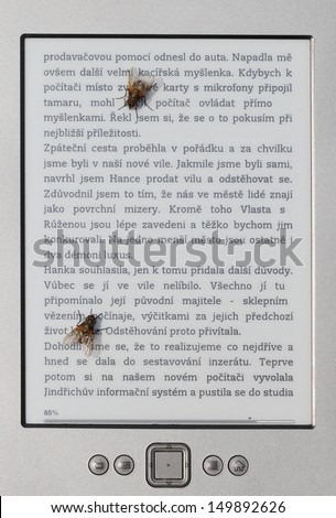 Two flies reading ebook. - stock photo