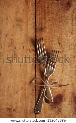 two fork tied by string on old wood, background - stock photo