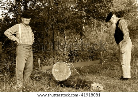 Two former farmer who saw a tree. - stock photo
