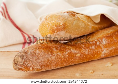 Two French baguettes on the table - stock photo