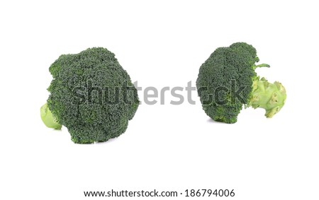 Two fresh broccoli pieces. Isolated on a white background. - stock photo