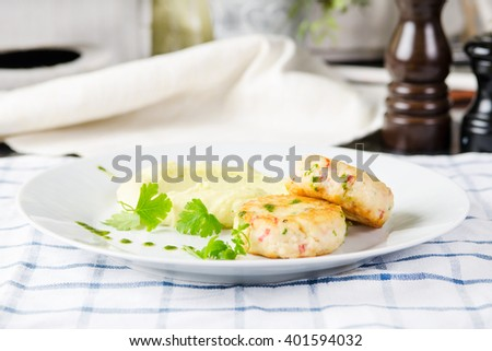 two fresh cod fishcakes with mashed potato and peas. stock image. - stock photo