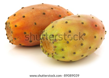 two fresh colorful cactus fruits on a white background - stock photo