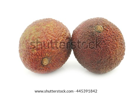 two fresh eat ripe avocado's on a white background - stock photo