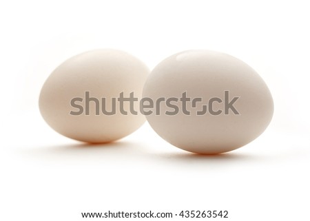 Two fresh eggs on the white background